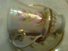 Beautiful mother of pearl coffee Cup with gold and roses.New